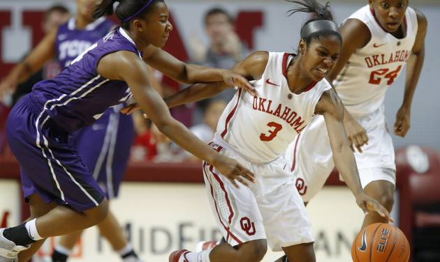 OU: Oklahoma's Aaryn Ellenberg (3) tries to control the ball beside TCU's Zahna Medley (14) during a women's college basketball game between the University of Oklahoma and TCU at the Lloyd Noble Center in Norman, Okla., Wednesday, Jan. 30, 2013. Oklahoma won 74-53. Photo by Bryan Terry, The OklahomanOU: