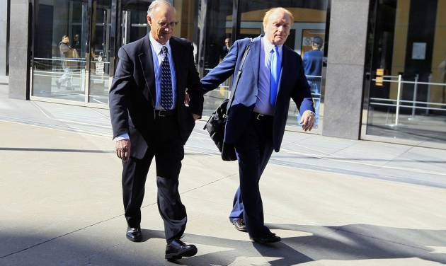 File - In this March 8, 2012, file photo, Robert Maegerle, left, walks out of a federal courthouse with attorney Jerome Froelich Jr. in San Francisco. Maegerle, a retired DuPont engineer, was convicted of economic espionage charges along with chemical engineer Walter Liew in March. Liew is facing more than 20 years in prison when he is sentenced Thursday, July 10, 2014, for a rare economic espionage conviction for selling technology for a white pigment to China. (AP Photo/Jeff Chiu, File)