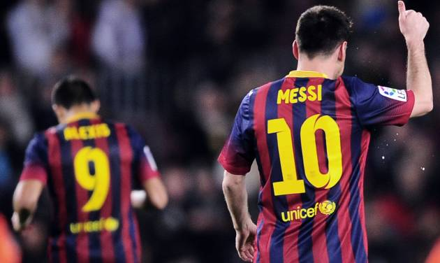 FC Barcelona's Lionel Messi, from Argentina, gestures after scoring against Athletic Bilbao during a Spanish La Liga soccer match at the Camp Nou stadium in Barcelona, Spain, Sunday April 20, 2014. (AP Photo/Manu Fernandez)