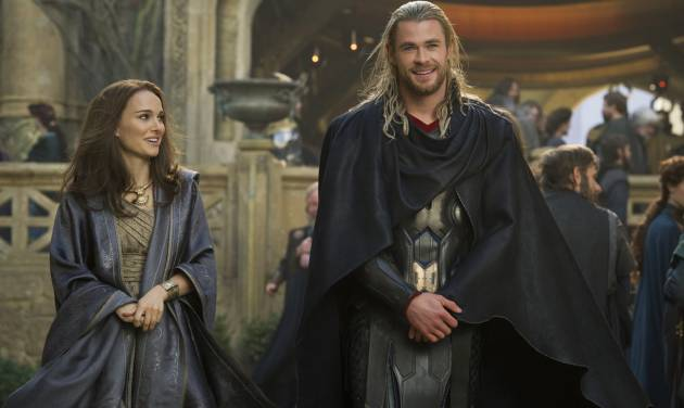 "FILE - This publicity photo released by Walt Disney Studios and Marvel shows Natalie Portman, left, as Jane Foster and Chris Hemsworth as Thor, in Marvel's ""Thor: The Dark World."" Disney is previewing several of the studio's upcoming live-action films for fans at the D23 Expo, Aug. 9-11, 2013, a three-day Disney extravaganza at the Anaheim Convention Center. ""Thor: The Dark World,"" ""Captain America: Winter Soldier,"" ""Muppets Most Wanted,"" ""Saving Mr. Banks"" and ""Tomorrowland"" are just some of the movies that will be teased at a Saturday morning presentation. (AP Photo/Walt Disney Studios/Copyright Marvel, Jay Maidment, File)"