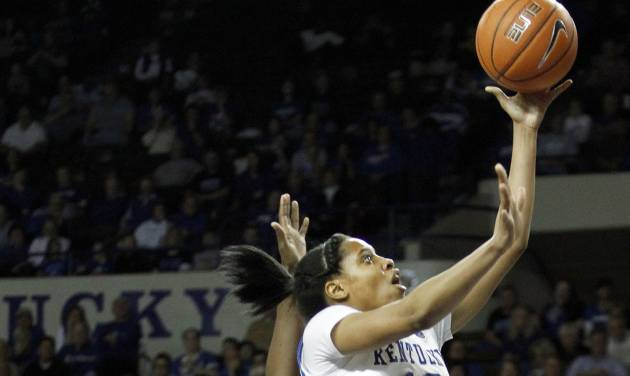 Kentucky's Bria Goss, right, shoots in front of South Carolina's Aleighsa Welch and Tiffany Mitchell, left, during the second half of an NCAA college basketball game, Thursday, Feb. 20, 2014, in Lexington, Ky. South Carolina won 81-58. (AP Photo/James Crisp)