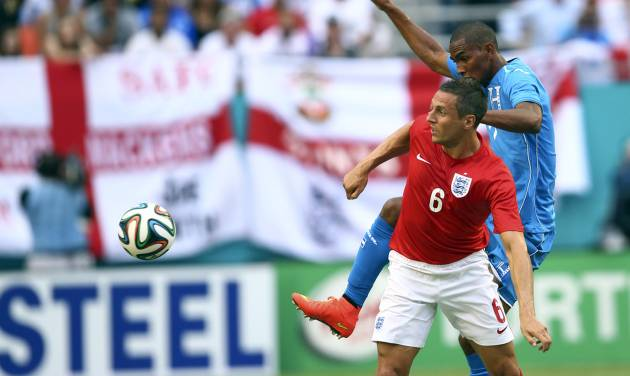England's Phil Jagielka (6) looks for the ball after Honduras' Jerry Bengtson (11) kicks the ball away during the first half of a friendly soccer match in Miami Gardens, Fla., Saturday, June 7, 2014. ( AP Photo/J Pat Carter)
