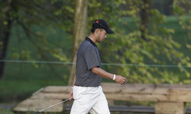 International's Hideki Matsuyama, of Japan, walks to the ninth hole during a foursome match at the Presidents Cup golf tournament at Muirfield Village Golf Club on Friday, Oct. 4, 2013, in Dublin, Ohio. (AP Photo/Darron Cummings)