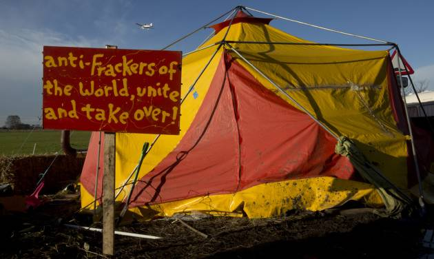 """A sign is seen outside a tent in an anti-fracking protest camp by an exploratory drill site for the controversial gas extraction process at Barton Moss in Manchester, England, Monday, Jan. 13, 2014.  Councils that back """"fracking"""" will get to keep more money in tax revenue as part of an """"all-out"""" drive to promote drilling, Prime Minister David Cameron has said. (AP Photo/Jon Super)"""