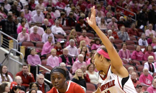 Rutgers' Kahleah Copper, left, attempts to drive around the defense of Louisville's Antonita Slaughter during the first half of an NCAA college basketball game Sunday, Feb. 23, 2014, in Louisville, Ky. (AP Photo/Timothy D. Easley)