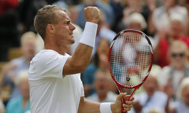 Lleyton Hewitt of Australia celebrates after winning a game against Jerzy Janowicz of Poland during their men's singles match at the All England Lawn Tennis Championships in Wimbledon, London, Friday, June 27, 2014.Janowicz won the match over five sets. (AP Photo/Ben Curtis)