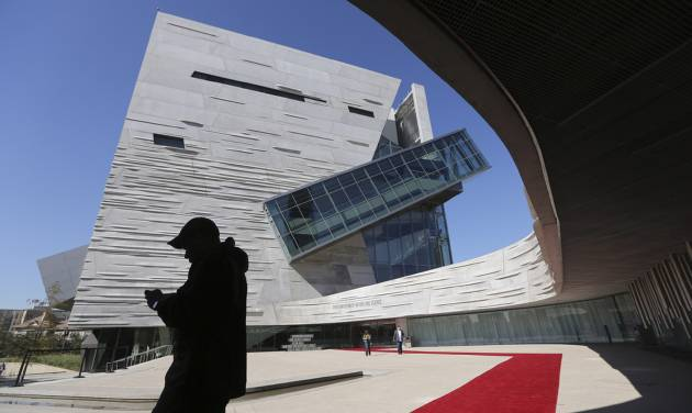 Visitors walk outside the front entrance of the of the Perot Museum of Nature and Science during a media preview in Dallas, Wednesday, Nov. 14, 2012. The museum set to open Dec. 1 was named for billionaire former presidential candidate Ross Perot and his wife, Margot, after their five children made a $50 million gift in honor of them. (AP Photo/LM Otero)