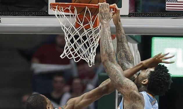 Denver Nuggets' Wilson Chandler, right, dunks on the Milwaukee Bucks' Giannis Antetokounmpo during the second half of an NBA basketball game Thursday, Feb. 20, 2014, in Milwaukee. (AP Photo/Jeffrey Phelps)