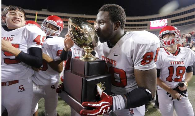 CLASS 5A HIGH SCHOOL FOOTBALL STATE CHAMPIONSHIP GAME / CELEBRATE / CELEBRATION: Carl Albert's Chantz Woodberry (80) kisses the trophy while celebrating the win over East Central during the Class 5A Oklahoma state championship football game between Carl Albert High School and Tulsa East Central High School at Boone Pickens Stadium on Saturday, Dec. 1, 2012, in Stillwater, Okla.   Photo by Chris Landsberger, The Oklahoman