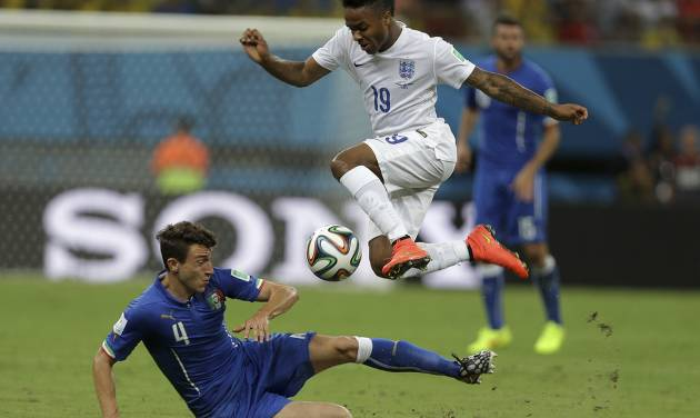 England's Raheem Sterling, top, is challenged by Italy's Matteo Darmian during the group D World Cup soccer match between England and Italy at the Arena da Amazonia in Manaus, Brazil, Saturday, June 14, 2014. (AP Photo/Martin Mejia)