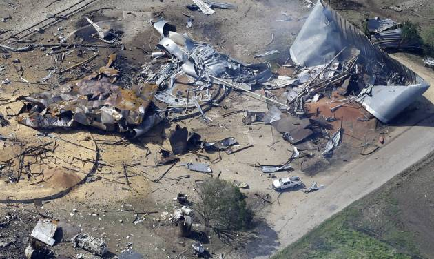 This aerial photo shows the remains of a fertilizer plant destroyed by an explosion and an emergency responders vehicle, bottom left, in West, Texas, Thursday, April 18, 2013. Rescuers searched the smoking remnants for survivors of Wednesday night's thunderous fertilizer plant explosion, gingerly checking smashed houses and apartments for anyone still trapped in debris while the community awaited word on the number of dead. (AP Photo/Tony Gutierrez)