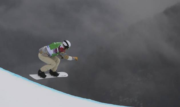 Nate Holland of the United States takes a drop during the third men's snowboard cross heat at the Rosa Khutor Extreme Park, at the 2014 Winter Olympics, Tuesday, Feb. 18, 2014, in Krasnaya Polyana, Russia. (AP Photo/Sergei Grits)