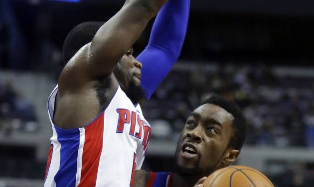 Philadelphia 76ers guard Tony Wroten (8) tries going to the basket against Detroit Pistons guard Will Bynum (12) during the first half of an NBA basketball game Saturday, Feb. 1, 2014, in Auburn Hills, Mich. (AP Photo/Duane Burleson)