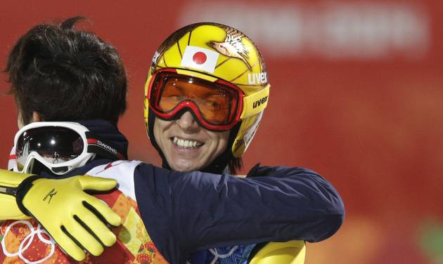 Japan's Noriaki Kasai smiles after winning the bronze during the ski jumping large hill team competition at the 2014 Winter Olympics, Monday, Feb. 17, 2014, in Krasnaya Polyana, Russia. (AP Photo/Matthias Schrader)