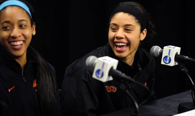 CORRECTS TEAM TO OKLAHOMA STATE, NOT FLORIDA GULF COAST- Oklahoma State's Tiffany Bias, left, and Brittney Martin laugh during a press conference at the women's NCAA college basketball tournament in West Lafayette, Ind., Friday, March 21, 2014.  Florida Gulf Coast plays Oklahoma State in a first-round game on Saturday. (AP Photo/Naples Daily News, Corey Perrine) FORT MYERS OUT, MAGS OUT, TV OUT