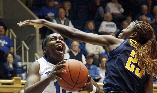 Duke's Chelsea Gray (12) drives to the basket against California's Gennifer Brandon (25) during the second half of an NCAA women's college basketball game in Durham, N.C., Sunday, Dec. 2, 2012. Duke won 77-63. (AP Photo/Gerry Broome)
