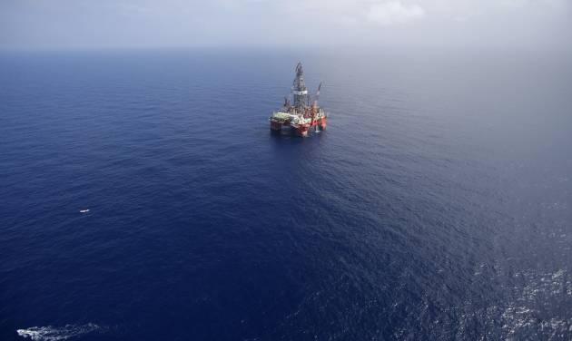 FILE - In this Nov. 22, 2013, file photo, the Centenario deep-water drilling platform stands off the coast of Veracruz, Mexico in the Gulf of Mexico. The administration of Mexico's President Enrique Pena has passed laws on Aug. 7, 2014, to open its oil, gas and electric industries to private and foreign investors after 76 years of state control. (AP Photo/Dario Lopez-Mills, File)