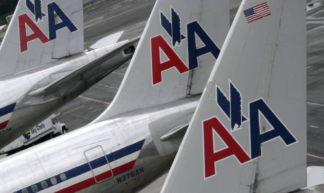 In this Wednesday, Aug. 1 2012 photo, American Airlines airplanes are at parked at the gate at JFK International airport in New York. U.S. Bankruptcy Judge Sean H. Lane on Tuesday, Sept. 4, 2012 threw out the union contract of American Airlines' pilots as part of the company's restructuring. A key part of the bankruptcy proceedings, the ruling clears the way for the Fort Worth, Texas-based airline to dramatically cut costs and quicken its emergence from Chapter 11 bankruptcy protection. (AP Photo/Mary Altaffer)