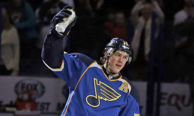St. Louis Blues' T.J. Oshie waves to the crowd after being named the star of the game after scoring the game-winning goal in overtime of an NHL hockey game against the Boston Bruins Thursday, Feb. 6, 2014, in St. Louis. The Blues won 3-2. (AP Photo/Jeff Roberson)