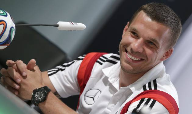 German national soccer player Lukas Podolski attends a news conference in Santo Andre near Porto Seguro, Brazil, Saturday, June 14, 2014.  Germany play in group G of the 2014 soccer World Cup. (AP Photo/Matthias Schrader)