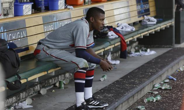 Atlanta Braves' B.J. Upton sits in the dugout after their 7-4 loss to the Detroit Tigers in an interleague baseball game in Detroit, Saturday, April 27, 2013. Upton struck out in the ninth inning for the Braves. (AP Photo/Carlos Osorio)