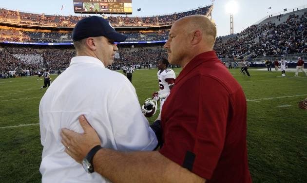 Penn State head coach Bill O'Brien, left, shakes hands with Temple head coach Steve Addazio after an NCAA college football game in State College, Pa., Saturday, Sept. 22, 2012. Penn State won 24-13. (AP Photo/Gene J. Puskar)