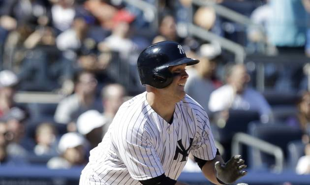 New York Yankees' Brian McCann follows through with a two-run home run during the sixth inning of a baseball game against the Boston Red Sox Saturday, April 12, 2014, in New York. (AP Photo/Frank Franklin II)