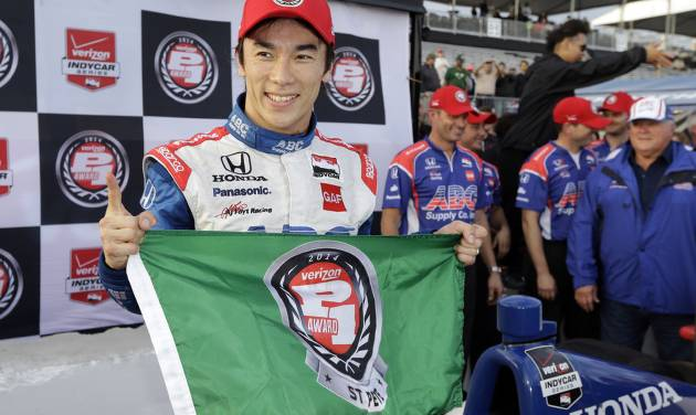 Takuma Sato, of Japan, celebrates after qualifying for the pole position for the IndyCar Firestone Grand Prix of St. Petersburg auto race Saturday, March 29, 2014, in St. Petersburg, Fla. The race starts Sunday afternoon. (AP Photo/Chris O'Meara)