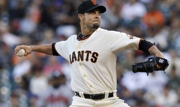 San Francisco Giants pitcher Ryan Vogelsong throws against the Atlanta Braves during the first inning of a baseball game in San Francisco, Tuesday, May 13, 2014. (AP Photo)