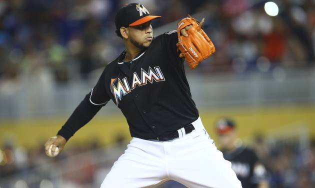 Miami Marlins starter Henderson Alvarez throws to the Seattle Mariners during the first inning of a baseball game in Miami, Saturday, April 19, 2014.  (AP Photo/J Pat Carter)