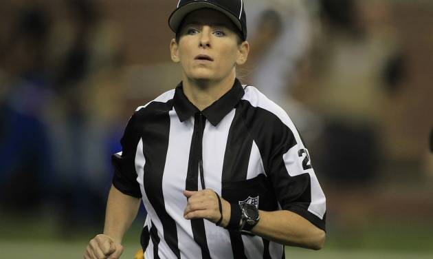 Line judge Shannon Eastin runs on the field during the first quarter of an NFL football game between the Detroit Lions and the St. Louis Rams in Detroit, Sunday, Sept. 9, 2012. (AP Photo/Carlos Osorio)