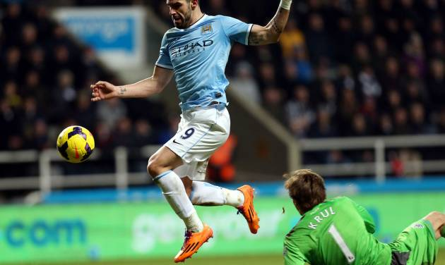Manchester City's Alvaro Negredo, left, goes on to scores a goal past Newcastle United 's goalkeeper Tim Krul, right, during their English Premier League soccer match at St James' Park, Newcastle, England, Sunday, Jan. 12, 2014. (AP Photo/Scott Heppell)