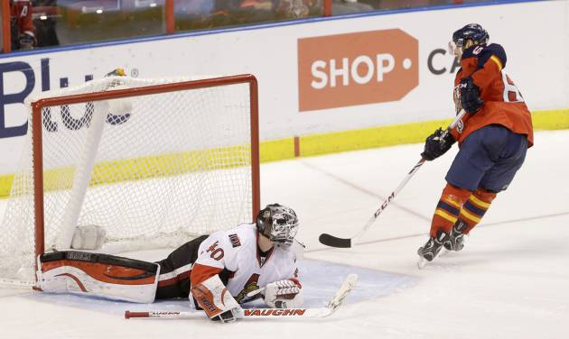 Florida Panthers center Vincent Trocheck scores against Ottawa Senators goalie Robin Lehner (40) during a shootout in an NHL hockey game, Tuesday, March 25, 2014 in Sunrise, Fla. The Panthers defeated the Senators 3-2. (AP Photo/Wilfredo Lee)