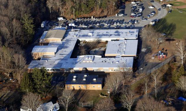 FILE - This Dec. 14, 2012 aerial file photo shows Sandy Hook Elementary School in Newtown, Conn., where a gunman shot 27 people dead, including 20 children. The Sandy Hook School Building Task Force meets Friday night, May 3, 2013, to debate whether to renovate or rebuild on the existing school site, or to construct a new school building on nearby property.  (AP Photo/Julio Cortez, File)