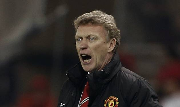Manchester United's coach David Moyes gives instructions to his players during a Champions League, round of 16, first leg soccer match  against Olympiakos at Georgios Karaiskakis stadium, in Piraeus port, near Athens, on Tuesday, Feb. 25, 2014. (AP Photo/Petros Giannakouris)
