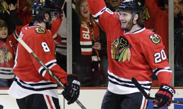 Chicago Blackhawks' Brandon Saad (20), right, celebrates with Nick Leddy (8) after scoring his goal during the second period in Game 2 of an NHL hockey second-round playoff series against the Minnesota Wild in Chicago, Sunday, May 4, 2014. (AP Photo/Nam Y. Huh)