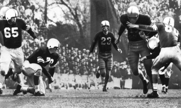 Elbert Van Buren (17), LSU fullback, gains three yards on a handoff from Charley Pevey (23).  He drags along Bobby Goad (80) as Norman McNabb (65) makes the tackle. The University of Oklahoma Sooners downed the Louisiana State University Tigers 35-0 in the 1950 Sugar Bowl in New Orleans. OKLAHOMAN ARCHIVE PHOTO