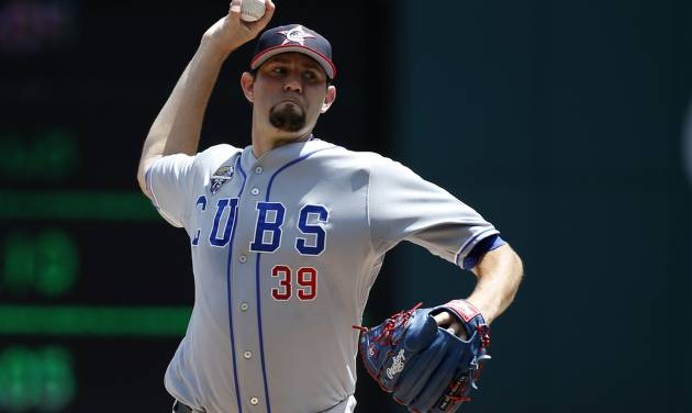 Chicago Cubs starting pitcher Jason Hammel (39) throws during the third inning of a baseball game against the Washington Nationals at Nationals Park, Friday, July 4, 2014, in Washington. (AP Photo/Alex Brandon)