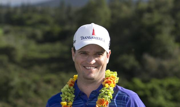 Zach Johnson holds the trophy after winning the Tournament of Champions golf tournament, Monday, Jan. 6, 2014, in Kapalua, Hawaii. Johnson pulled away with three straight birdies on the back nine at Kapalua and closed with a 7-under 66 for a one-shot victory over Jordan Spieth on Monday.  (AP Photo/Marco Garcia)