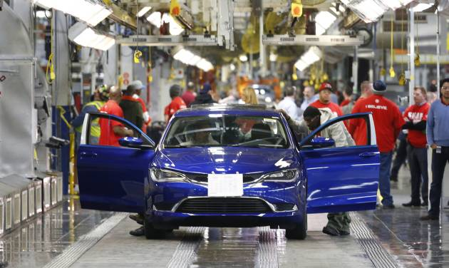 In this March 14, 2014 file photo, a 2015 Chrysler 200 automobile moves down the assembly line at the Sterling Heights Assembly Plant in Sterling Heights, Mich. All automakers report U.S. sales figures for August 2014 on Wednesday, Sept. 3, 2014. Chrysler and Nissan both posted double-digit U.S. sales gains last month, signs of strong August for the industry. (AP Photo/Paul Sancya, File)