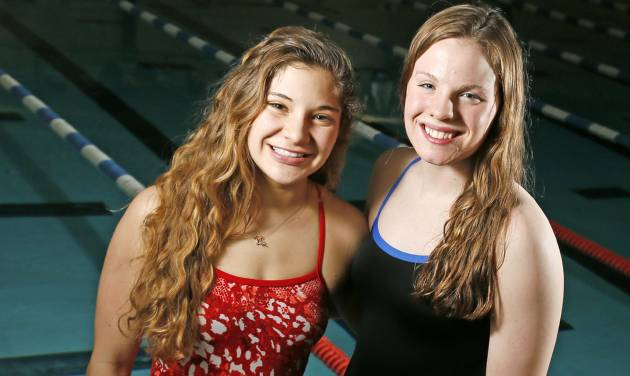 HIGH SCHOOL SWIMMING: High school swimmers Kasey Rein of Piedmont, left and Jessi Hildebrand of Newcastle pose for a photo at the Lighthouse in Oklahoma City, Thursday, Feb. 14, 2013. Photo by Nate Billings, The Oklahoman