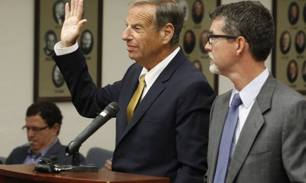 Former San Diego Mayor Bob Filner, left, stands with counsel in court and takes an oath before he pleads guilty on state charges of felony false imprisonment Tuesday, Oct. 15, 2013 in San Diego. Filner pleaded guilty to one criminal count of false imprisonment by violence, fraud, menace and deceit and two misdemeanor counts of battery. The charges involve three unnamed women victims. Filner, 71, resigned in late August, succumbing to intense pressure after at least 17 women brought lurid sexual harassment allegations. (AP Photo/UT-San Diego, John Gibbins, Pool)