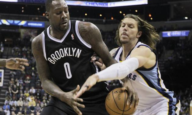 Memphis Grizzlies' Mike Miller, right, tries to strip the ball away from Brooklyn Nets' Andray Blatche (0) in the first half of an NBA basketball game in Memphis, Tenn., Saturday, Nov. 30, 2013. (AP Photo/Danny Johnston)