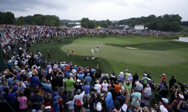 Rory McIlroy, of Northern Ireland, celebrates after winning on the the PGA Championship golf tournament at Valhalla Golf Club on Sunday, Aug. 10, 2014, in Louisville, Ky. (AP Photo/David J. Phillip)