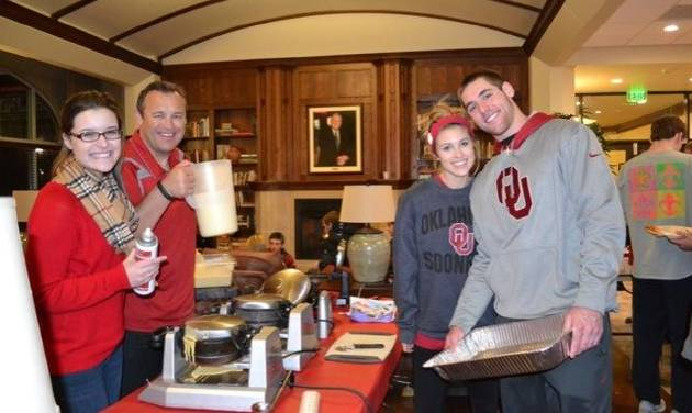 """OU quarterback Trevor Knight, right, served pancakes to fellow Headington Hall residents last year during a """"Late-Night Breakfast"""" event. PHOTO PROVIDED"""