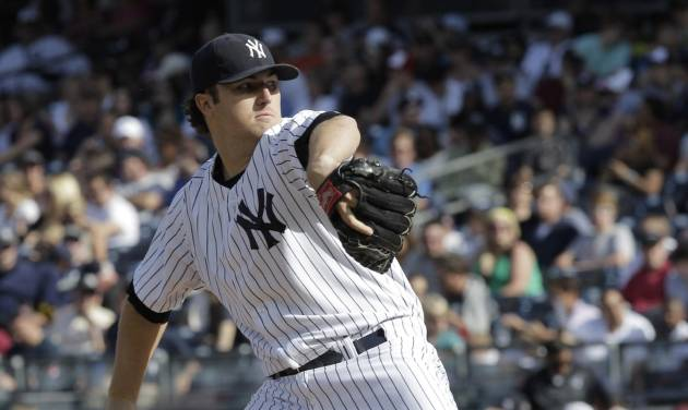 New York Yankees pitcher Phil Hughes throws in the third inning of a baseball game against the Seattle Mariners on Saturday, May 12, 2012 in New York. (AP PhotoPeter Morgan)