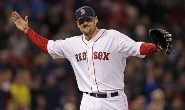 Boston Red Sox starting pitcher John Lackey reacts after getting Texas Ranger J.P. Arencibia to ground out to end the top of the seventh inning of a MLB American League baseball game at Fenway Park, Monday, April 7, 2014, in Boston.(AP Photo/Charles Krupa)