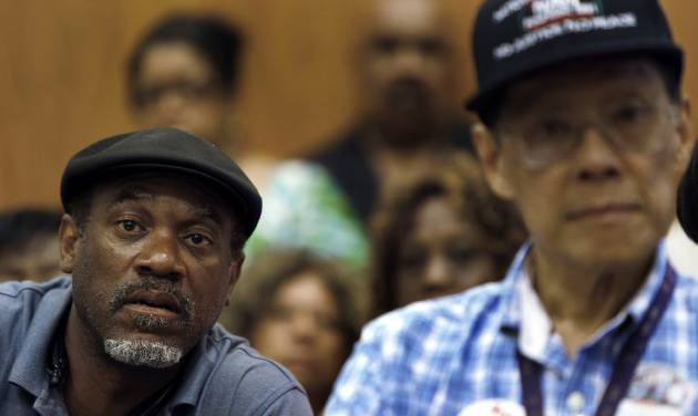 FILE - In this July 22, 2013, file photo, Tony Brown, left, a Department of Transportation retiree, listens to union leaders talk about what Detroit's bankruptcy filing means to thousands of retirees during a meeting in Detroit. Monday, Aug. 19, 2013, is the deadline for a host of banks, bond insurers, two employee pension systems and others standing to lose big if a federal judge declares Detroit insolvent to legally file their objections to the largest municipal bankruptcy in U.S. history.  (AP Photo/Paul Sancya, File)