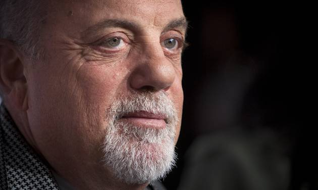 """FILE - This Oct. 15, 2013 file photo shows Billy Joel at the Elton John AIDS Foundation's 12th Annual """"An Enduring Vision"""" benefit gala at Cipriani Wall Street in New York. Joel opened up Monday, April 28, 2014, in a two-hour-plus interview in front of 150 people in New York . Pink, Boyz II Men and Idina Menzel also performed his hits during the event which aired live on Howard Stern's SiriusXM radio show. (Photo by Carlo Allegri/Invision/AP, File)"""