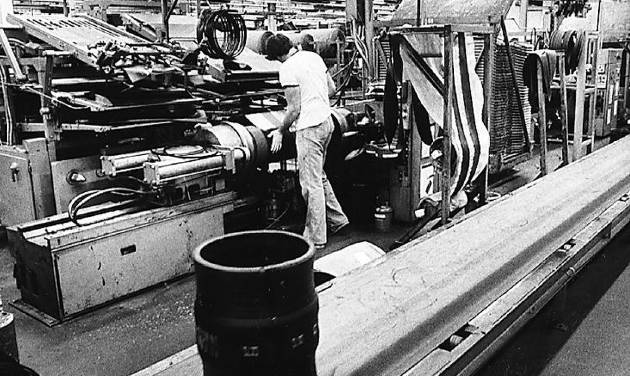 A worker at the Dayton Tire plant in Oklahoma City is shown in this photo from April 1980.   - PHOTO BY DAVID MCDANIEL, THE OKLAHOMAN